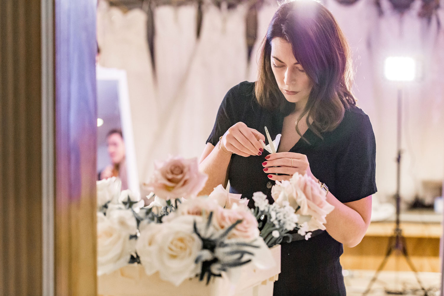 florist making bouquet bridal wedding flowers london