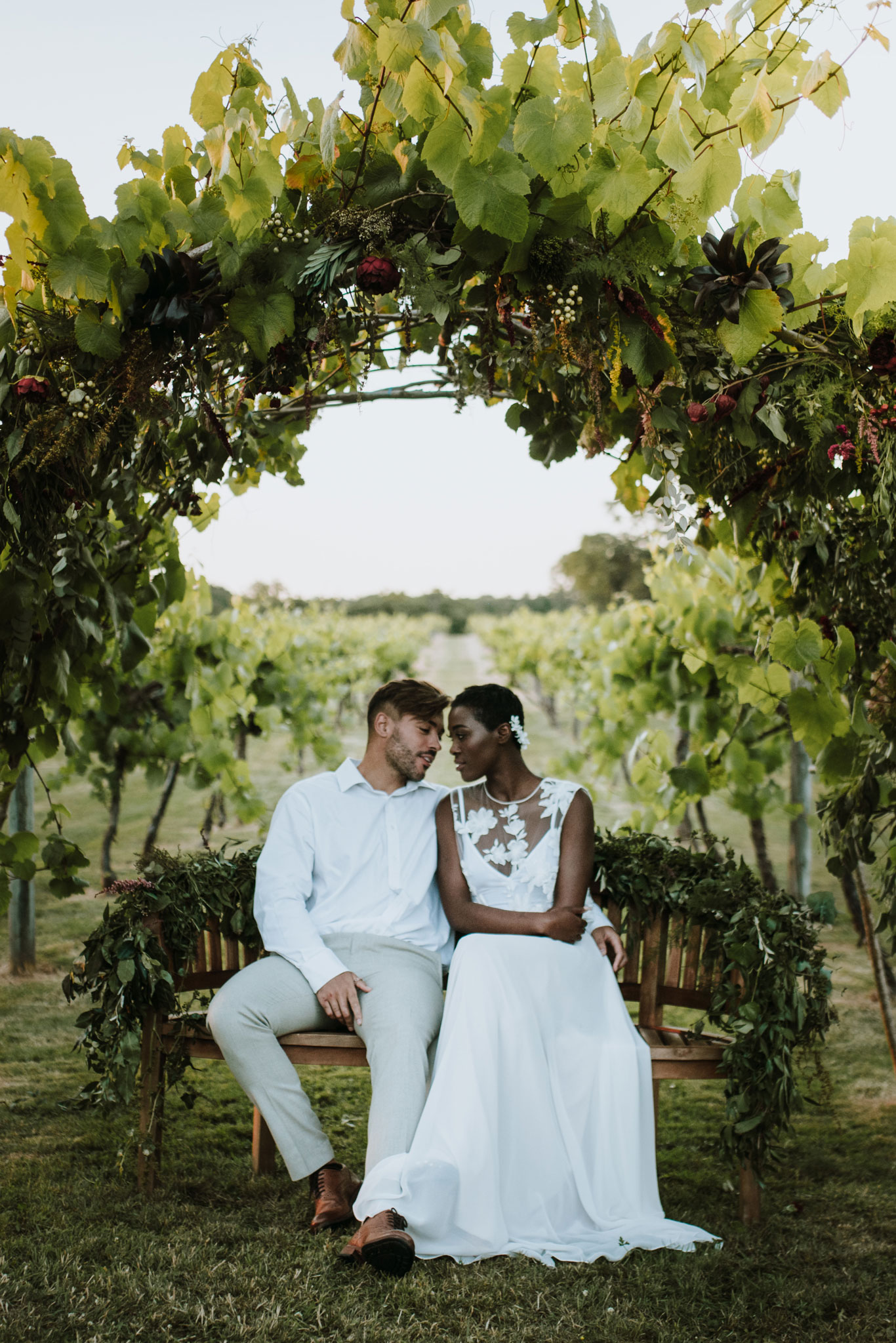 Couple, floral arch, wedding arch, just married, bride, groom