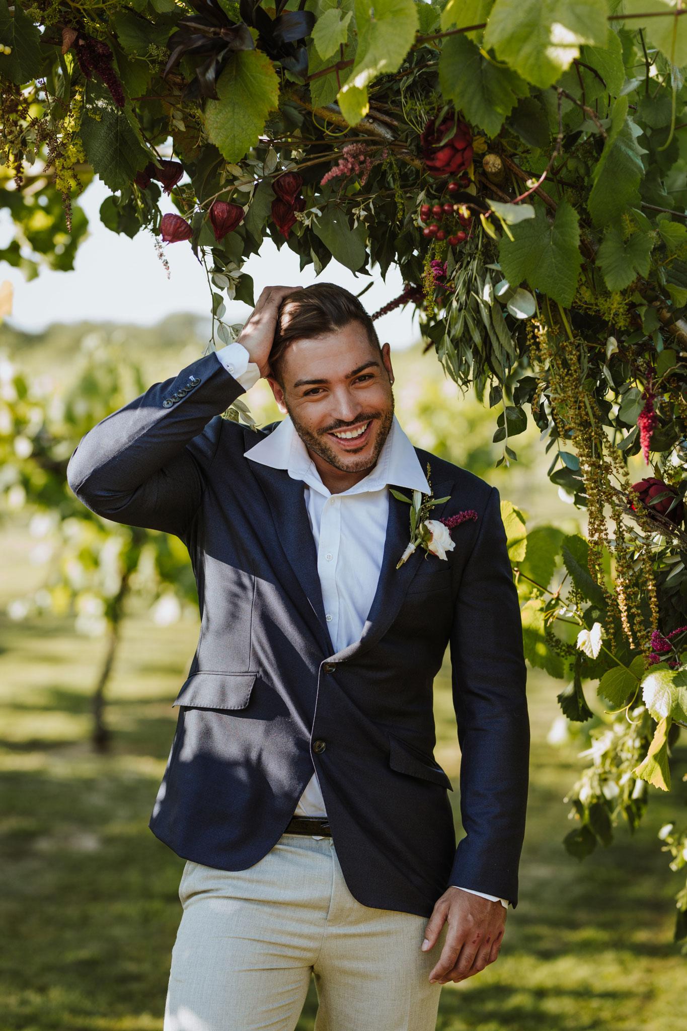 Floral arch, wedding arch, wedding flowers, vineyard, groom