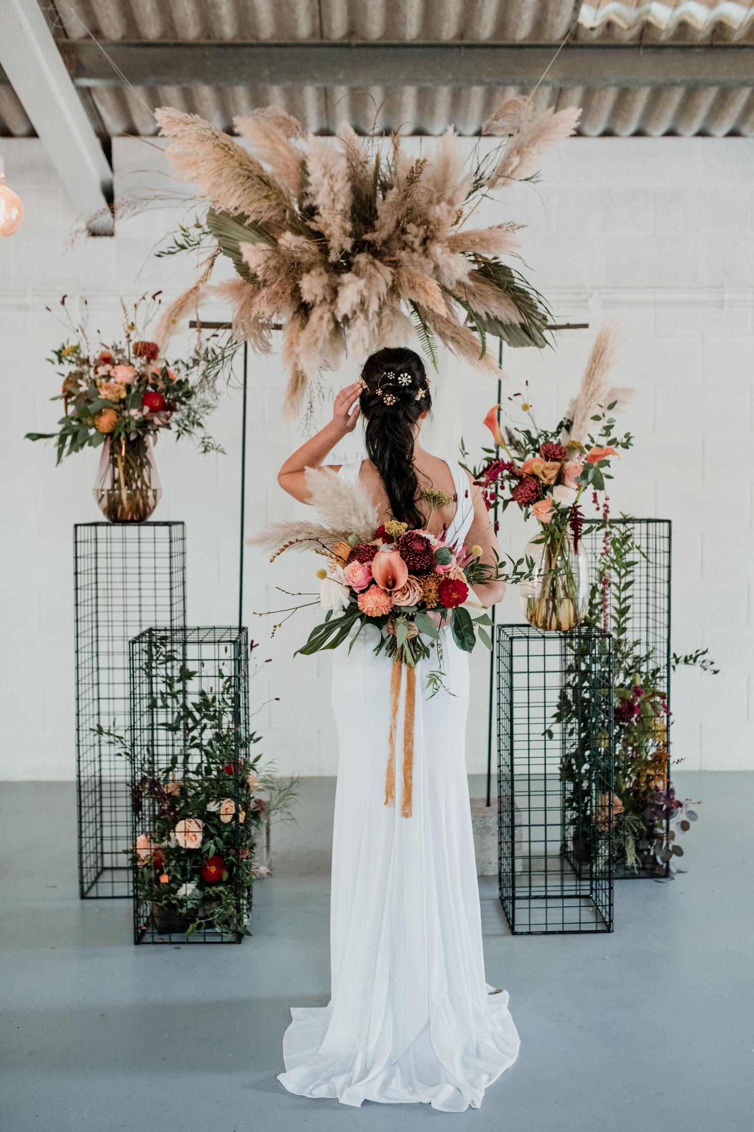 pampas grass cloud wedding ceremony flowers bridal bouquet