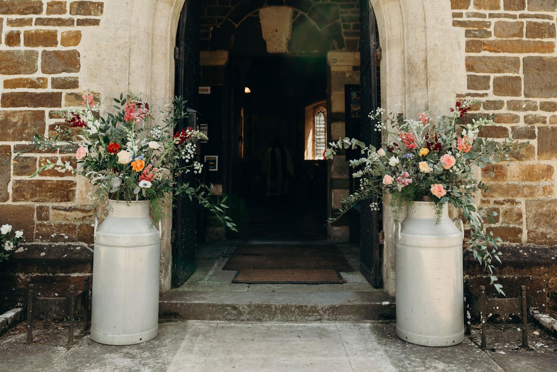 Iris and Co wedding flowers bridal bouquet London wedding church florist  milk churns flowers
