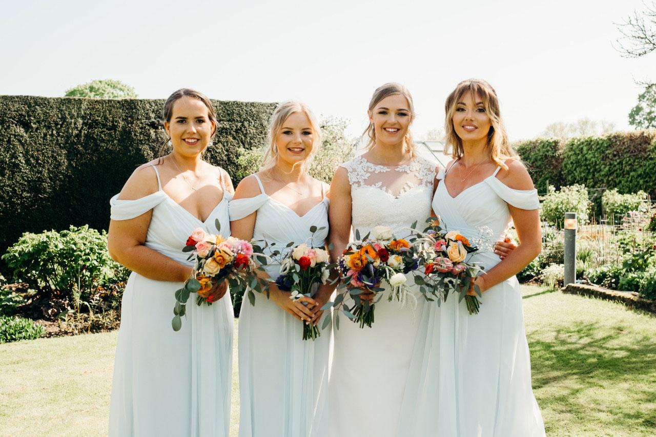 Iris and Co wedding flowers bridal bouquet London wedding florist bridesmaid bouquet dress