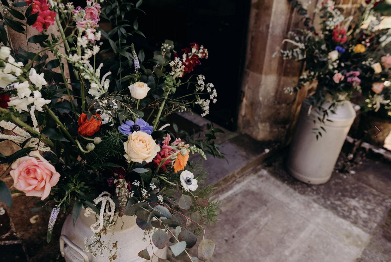 wedding flowers, London florist, flower installation, chandelier, greenery, foliage, milk churns, seasonal flowers, wedding florist