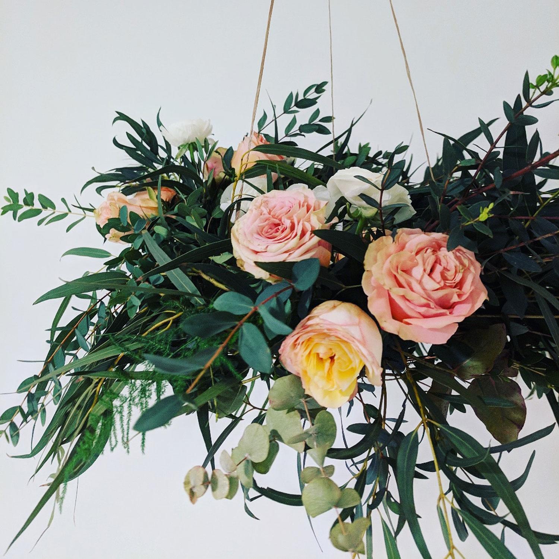 wedding flowers, London florist, flower installation, chandelier, greenery, foliage