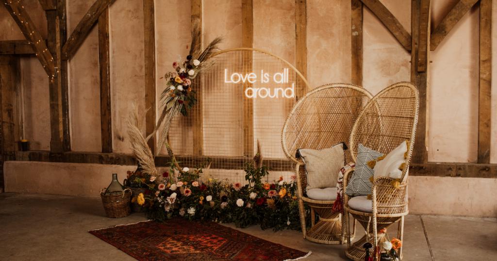 boho wedding ceremony area with flowers and pampas grass iris co