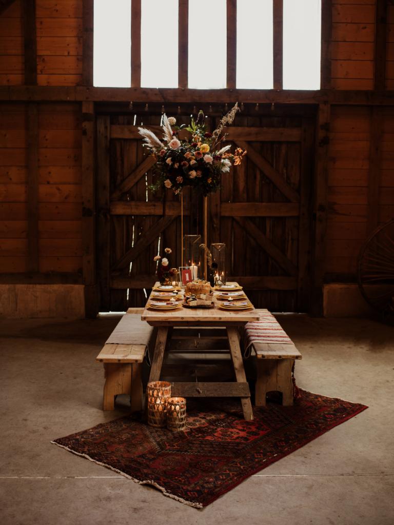 tall boho table flowers on a picnic table wedding breakfast
