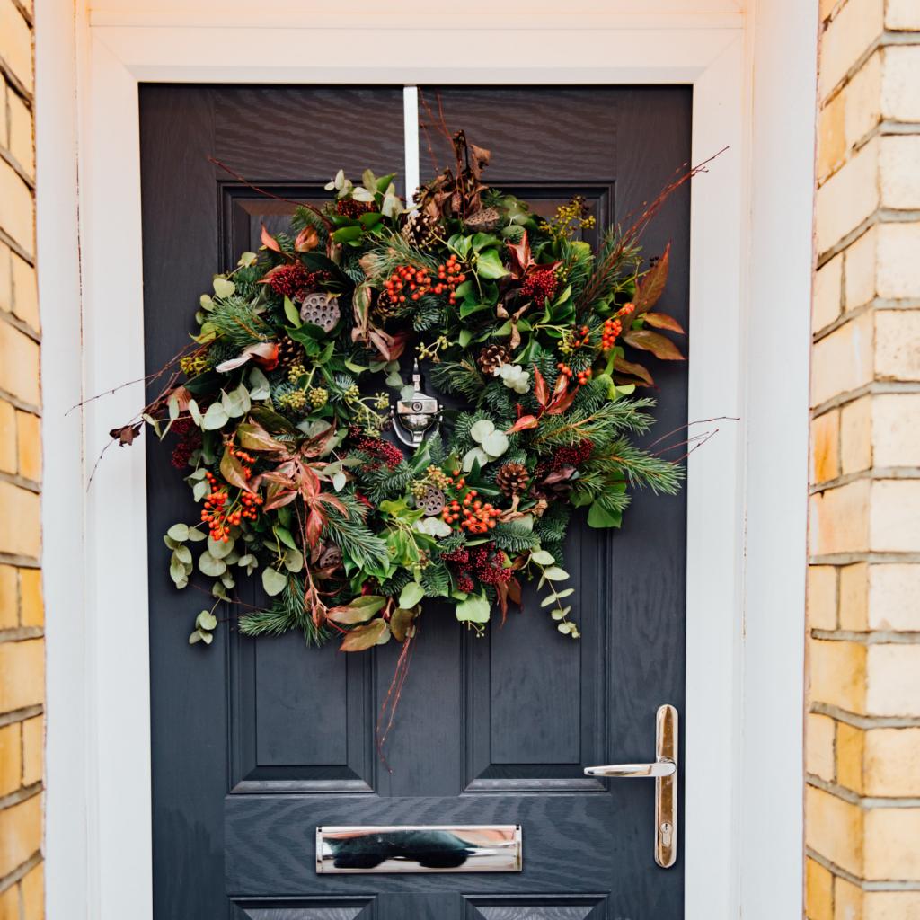 luxury real christmas wreath hanging on door