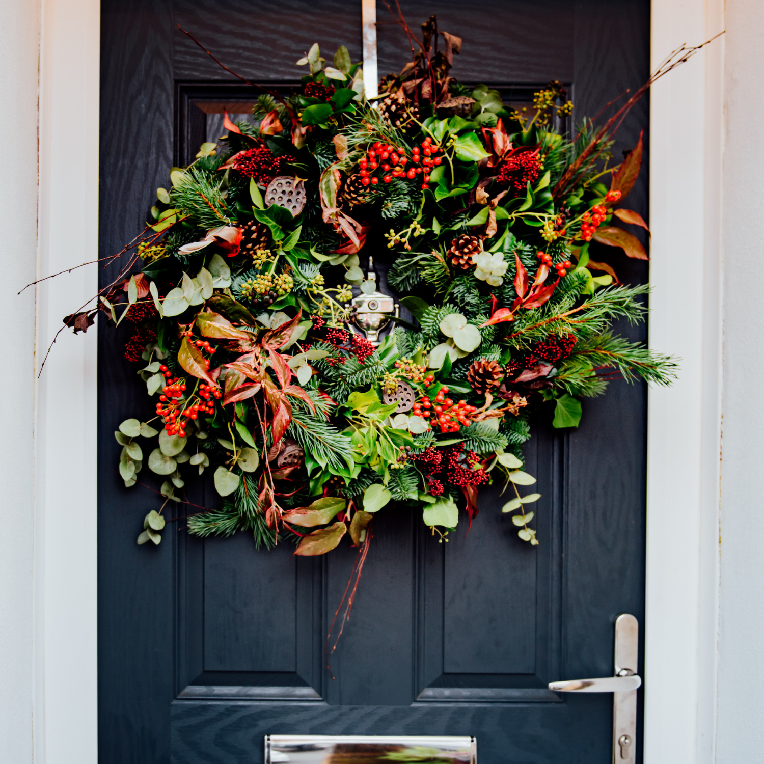 luxury real christmas wreath hanging on door