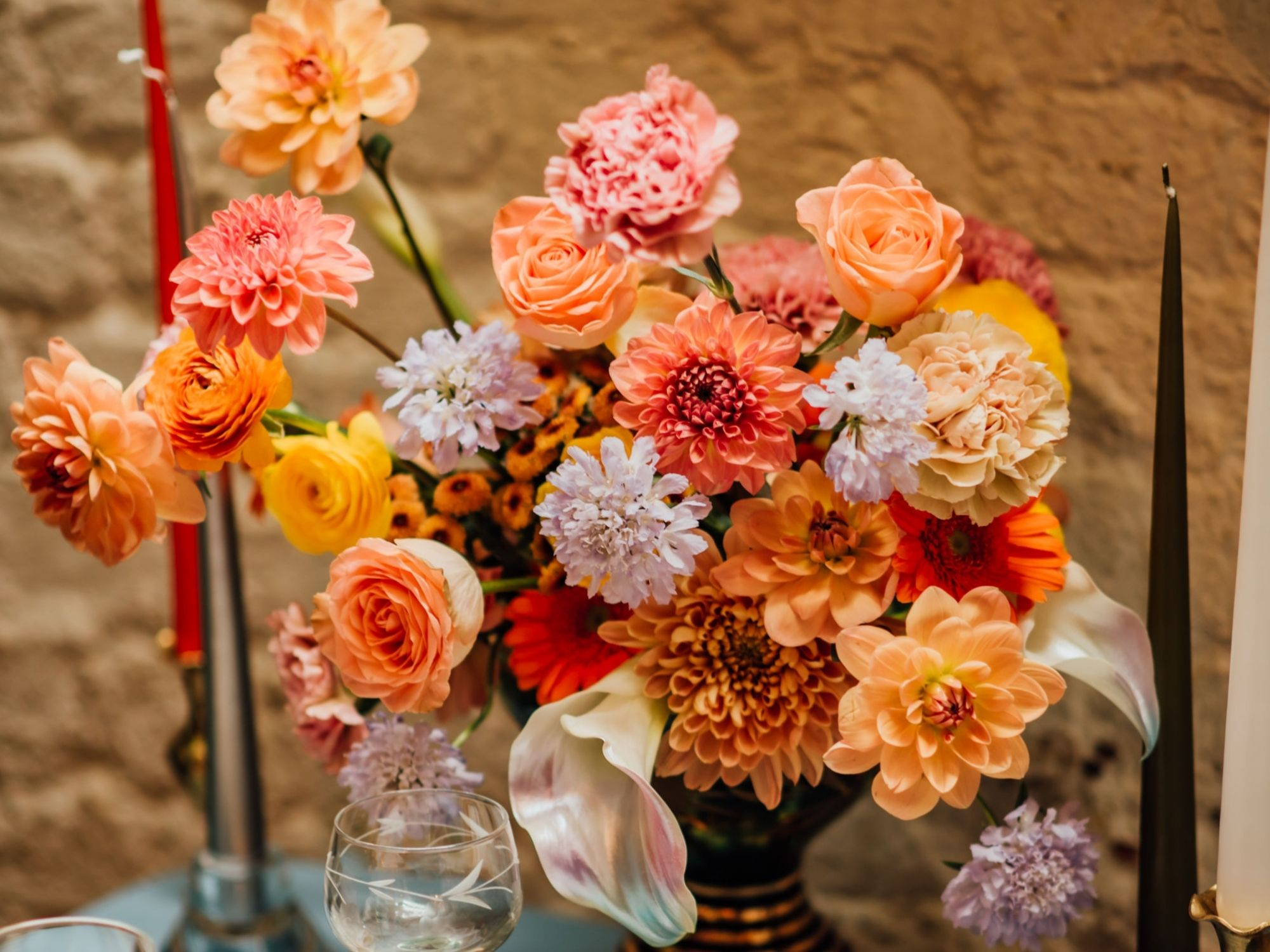 colourful table centrepiece flowers orange pink lilac