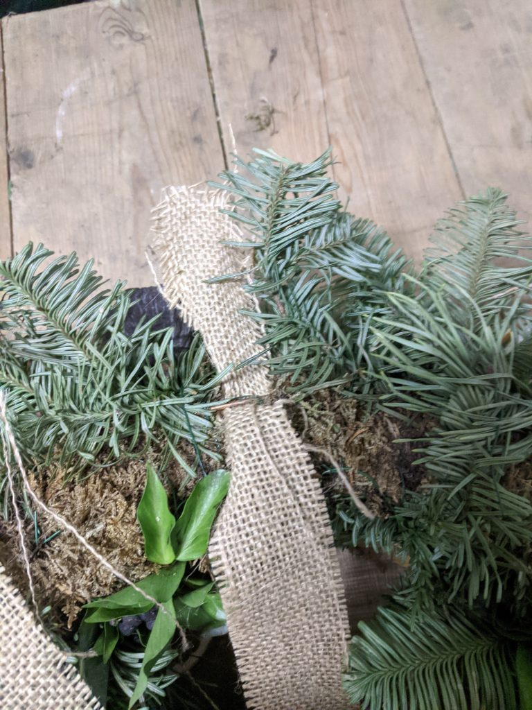 how to hang a Christmas wreath with ribbon