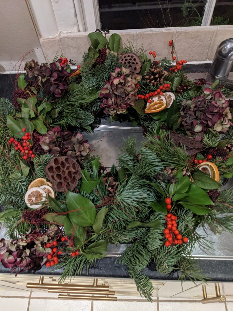 How to water a christmas wreath in sink on draining board